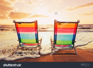 stock-photo-hawaiian-vacation-sunset-concept-two-beach-chairs-at-sunset-98725346