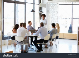 stock-photo-colleagues-at-an-office-meeting-275789651